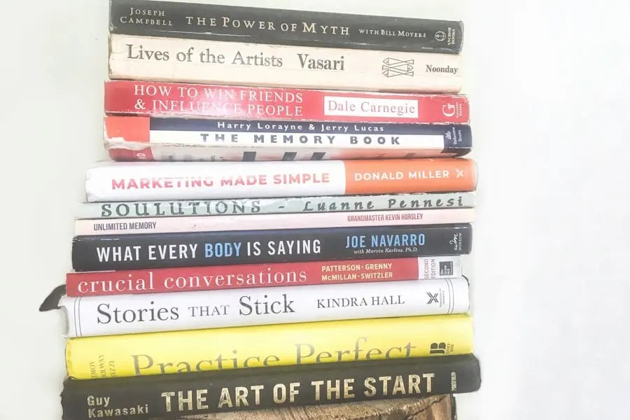 A stack of twelve books to read on a reading challenge