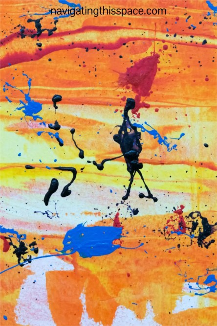 warm bold colors on a canvas displayed by drip technique