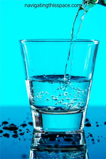 glass of water being filled reminding you to stay healthy by drinking water