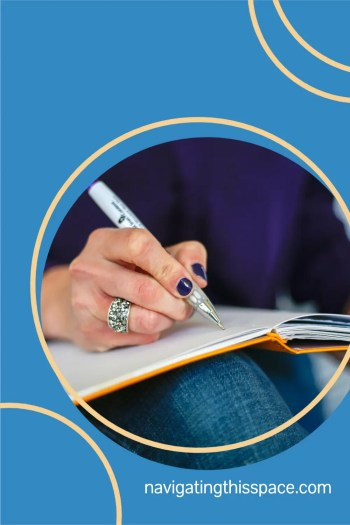 a manicured hand writing in a journal to experience the positive benefits of journal writing