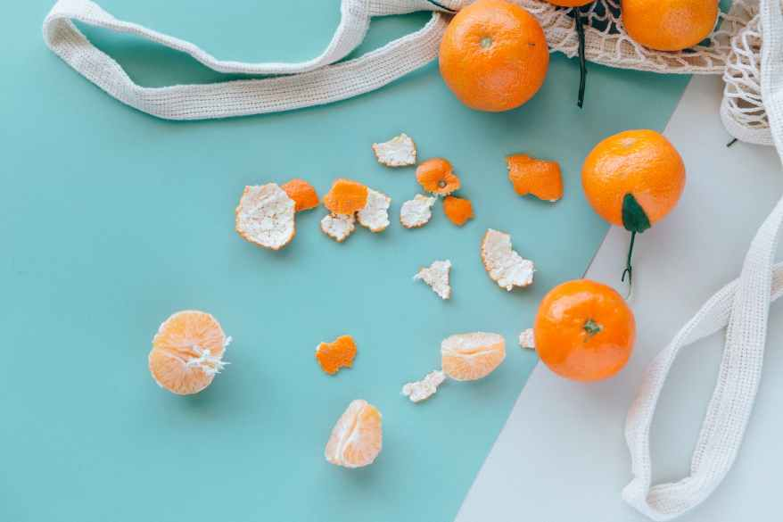 orange fruits on white table