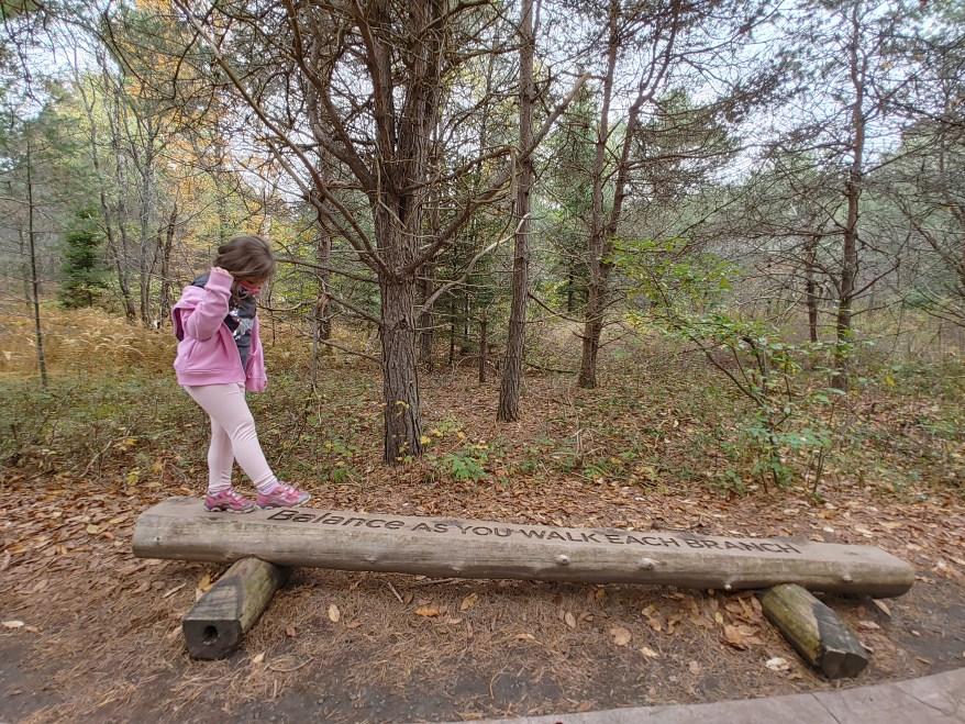 hiking with kids, balancing on a log