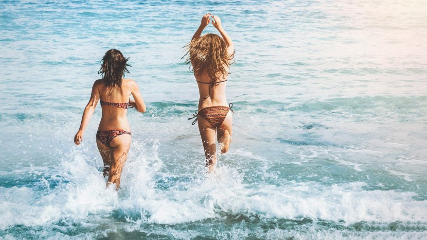 girls running in the ocean