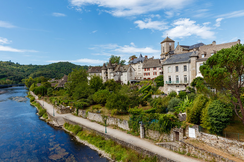 Argentat buildings along a river, family friendly cities in France