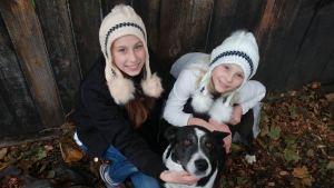 cream-white-pom-pom-hats-girls-w-dog