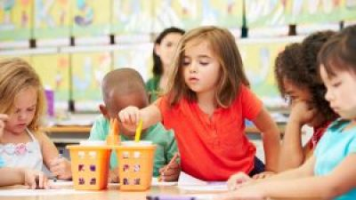 Early child development through trial and error