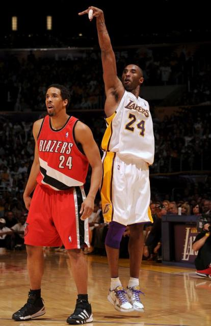 Kobe Bryant follow throughs on a 3 over Andre Miller (1)
