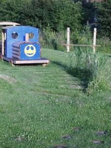 Oakes FF- play train and inset sleepers and planting
