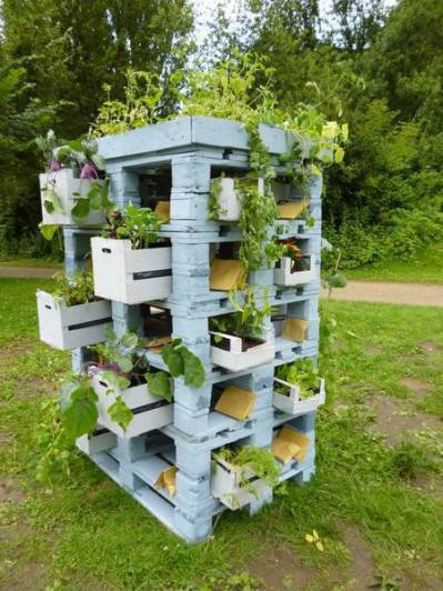 Pallets and crates as a planter tower http://bit.ly/10zgVwM
