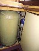 Cable from solar panels running through calorifier cupboard, through new hole in floor to battery compartment