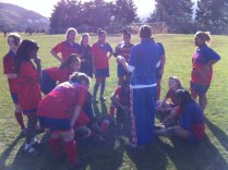 Football Girls get Ms Hodel's inspirational halftime talk