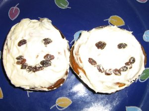 two smiley face cupcakes