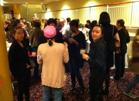 Candid shot of the audience enjoying cupcakes, fruit, and wine!