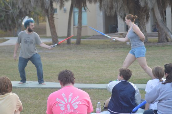"""Professor Shipman and thesis student Katherine Ervin dual it out """"Star Wars"""" style."""