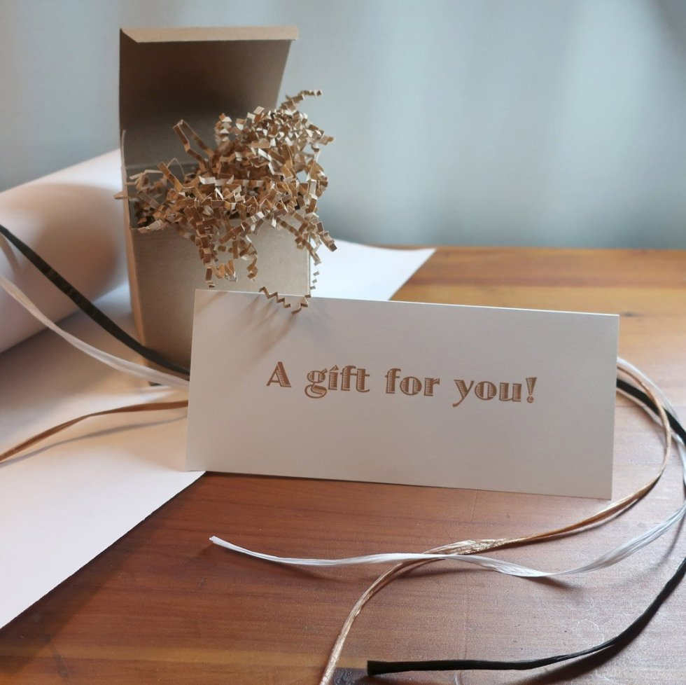 "Example of gift wrapping with a card that reads ""A gift for you!"""