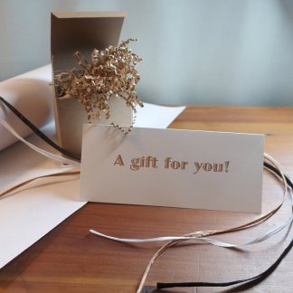 """Example of gift wrapping with a card that reads """"A gift for you!"""""""