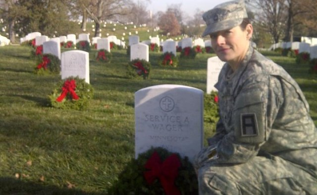 MSG Erica Lehmkuhl laying wreaths at Veterans as part of Wreaths Across America.