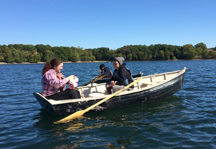 This photograph was submitted by Lisa Lobel, Assistant Professor in the Department of Mathematics and Sciences at Wheelock College. These students are collecting phytoplankton and measuring temperature, dissolved oxygen, and nutrients at different depths to assess the vertical heterogeneity of Jamaica Pond in Boston.