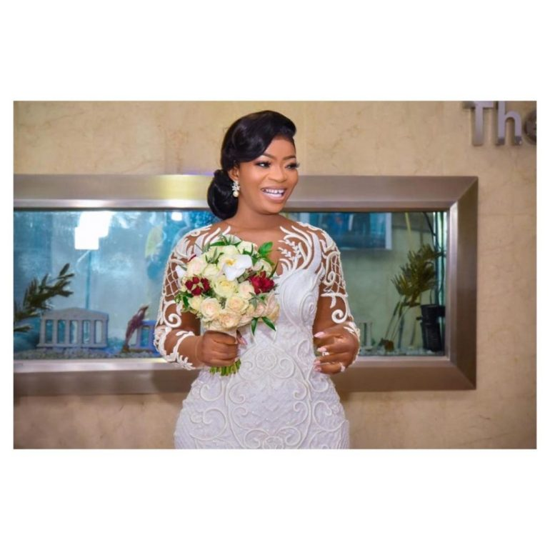 wedding dress with detailed lace sleeves april by kunbi