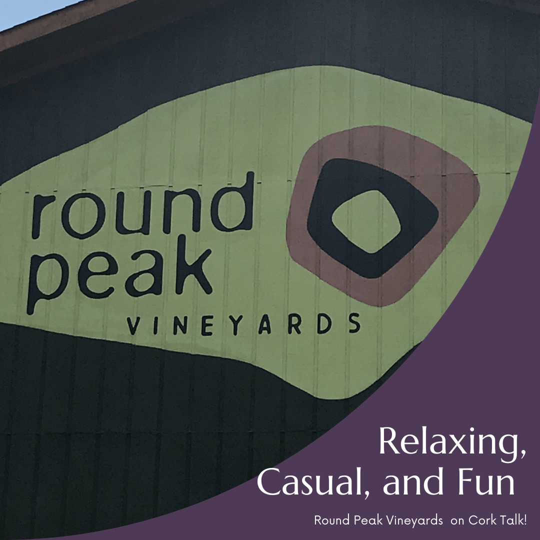 A picture of the Round Peak Vineyards logo on the tasting room at the winery.
