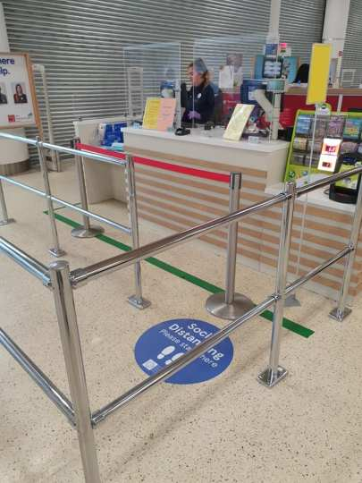 Tesco Covid19 safety-equipment. Floor social distance signs and protective staff screens.