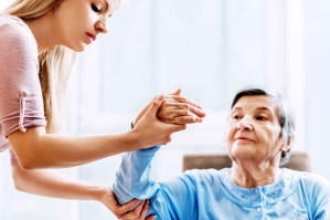 A senior woman receiving physical therapy.