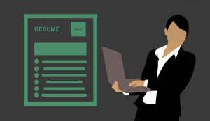 A stylized illustration of a resume is next to a stylized illustration of a person in business attire holding a laptop.
