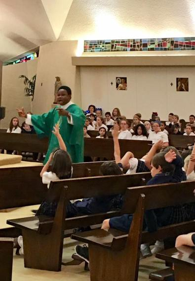 Dcn. Cletus at St. Pius School Mass 2