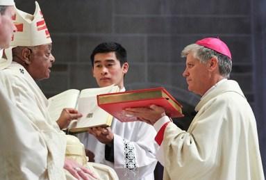 Viet Pham serving as book bearer for the Ordination of Atlanta Bishop Shlesinger
