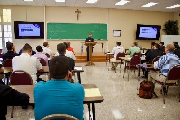The Seminarian Association shares house practices with the new seminarians.