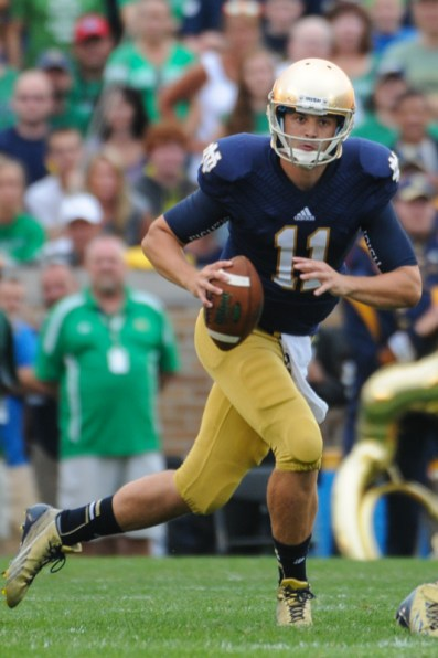 Former Irish Quarterback Tommy Rees looks to pass during his time as Notre Dame quarterback. Rees replaced Chip Long as offensive coordinator in January after serving as quarterbacks coach for three seasons.