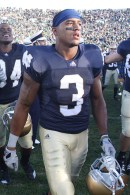 The Kelly era debuted with Notre Dame's classic navy home jerseys. Former receiver Michael Floyd is pictured after beating Purdue in 2010.