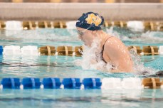 Senior Lauren Stauder competes in the breast stroke section of the 200IM.