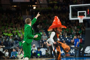 The Leprechaun holds a dance-off against Oklahoma State's mascot, Pistol Pete.