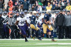 Irish senior quarterback Everett Golson sprints for a 61-yard touchdown in the first quarter.