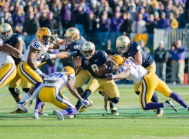Irish quarterback Malik Zaire attempts to evade LSU defenders.