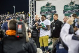 Notre Dame sophomore quarterback Malik Zaire receives The Franklin American Mortgage Music City Bowl MVP award after Notre Dame defeated LSU, 31-28, at LP Field on Tuesday.