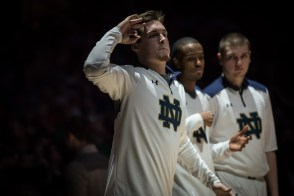 Irish senior captain Pat Connaughton greets his teammates during introductions before Wednesday's game. Michael Yu | The Observer