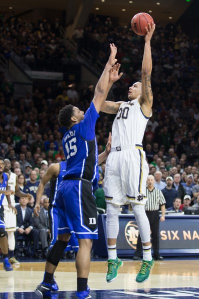 Junior forward Zach Auguste goes up for a shot. Jodi Lo | The Observer