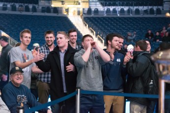"""Irish linebacker Joe Schmidt (fourth from left) cheers on his former teammate Tyler """"Tuna"""" Plantz as he fights Jackson """"The Flash"""" Wrede. Michael Yu 
