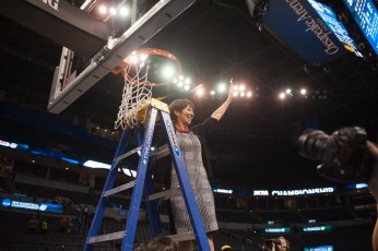 Irish head coach Muffet McGraw cuts down the net after the Irish top Baylor in Sunday's Elite Eight.