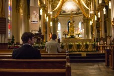 Students pray before the start of the Paschal Vigil Mass on Saturday.