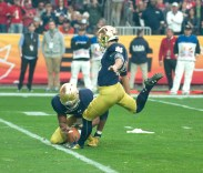 Irish freshman kicker Justin Yoon prepares to kick an extra point during Notre Dame's 44-28 loss to Ohio State in the Fiesta Bowl on Friday.