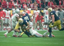 Irish junior receiver Will Fuller tries to shed a tackle during Notre Dame's 44-28 loss to Ohio State in the Fiesta Bowl on Friday. Fuller had six catches for 113 yards and a score in the defeat.