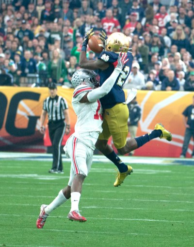 Senior receiver Chris Brown battles for the ball in the air with Ohio State sophomore Eli Apple during Notre Dame's 44-28 loss to the Buckeyes on Friday in Glendale, Arizona. Brown had four catches, including a touchdown, for 35 yards in the game.