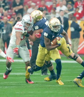 Irish freshman running back Josh Adams breaks through a gap during Notre Dame's 44-28 loss to Ohio State on Friday in the Fiesta Bowl at University of Phoenix Stadium in Glendale, Arizona.