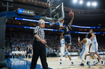 Irish junior forward V.J. Beachem throws down a dunk during the first half of Notre Dame's 88-74 Elite Eight loss to North Carolina on Sunday.
