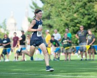 Irish sophomore Anthony Williams runs Friday in the National Catholic Invitational. Williams, who finished third, led the Irish men to a second-place team finish at the meet.