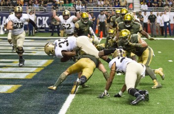 An Army running back plows into the end zone.