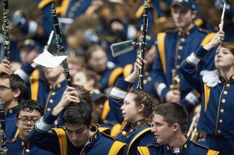 Members of the Notre Dame marching band watch the game in San Antonio.